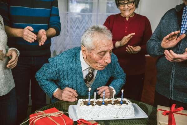 Elderly man celebrates birthday with family