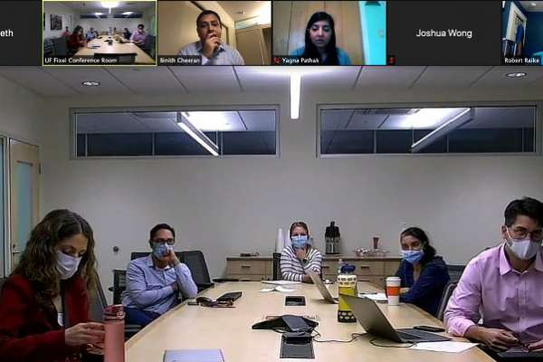 researchers discussing science over a zoom call