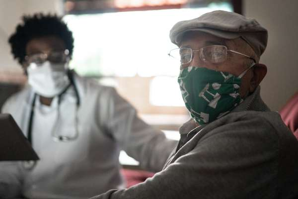 older patient with a face mask on